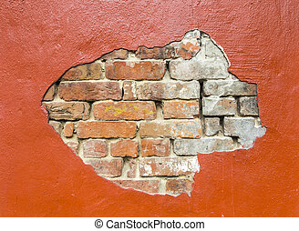 damaged wall with bricks under plaster