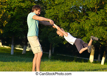 Family Father Man and Son Boy playing Outdoor park flying...