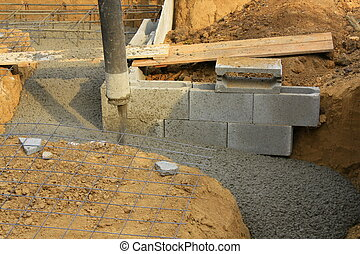 Concreting the foundations of a house with a pump