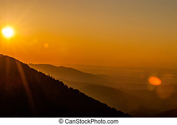 Sun rising over snowy mountains of Smokies in early spring...