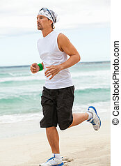 man is jogging on the beach summertime sport fitness run...