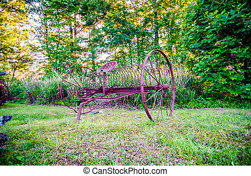 abandoned rusty agricultural farming equipment