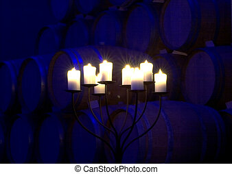 Candles in the cellar - Candles lit in front of many barrels