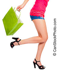 Running after Fashion - Womans legs running with shopping...
