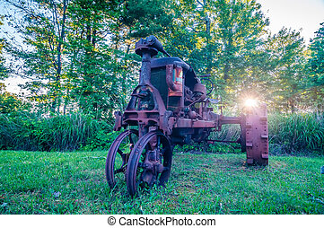 old rusty agriculture farm tractor