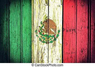 Mexican flag - Official Mexican flag on the wooden...