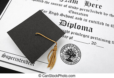 hs diploma - a mini graduation cap on a high school diploma...