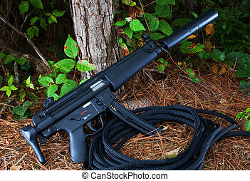 Assault rifle - Suppressed assault rifle that is at a forest...