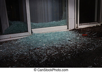 Break in - Shattered glass in the night near a sliding glass...