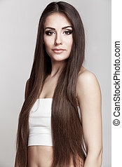 beautiful young brunette woman with long hair