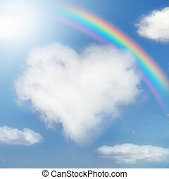 Fluffy cloud of the shape of heart and rainbow in the sky