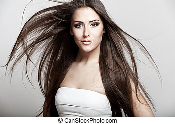 beautiful young brunette woman with long hair -...