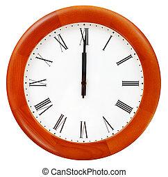 midnight on the round wall clock - twelve o clock midnight...