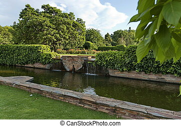 Pond with waterfall in garden