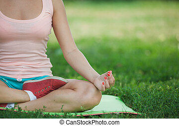 young girl sitting in the lotus position