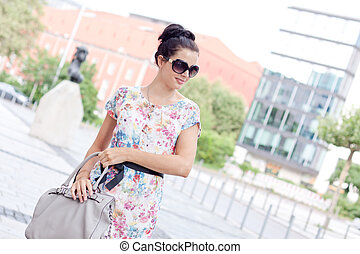 attractive woman with sunglasses in the city summertime