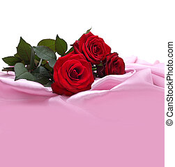 red roses on silk