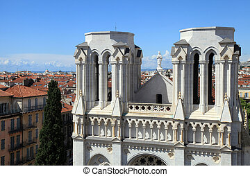 Basilique Notre Dame de Nice and red tile roofs of old...