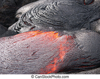 Lava print: detail of flowing lava magma stream.
