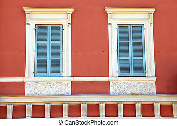 old french blue shutter windows in red house, Nice, France -...