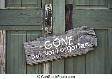 Gone but not forgotten. - Old sign on green doors.