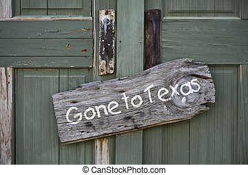 Gone to Texas - Gone to Texas sign on old door