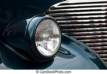 Vintage Car Headlight - Macro view of a classic automobile