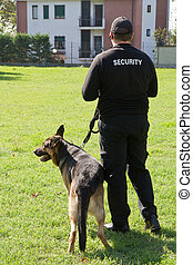 security guard  - back of a security guard with a dog