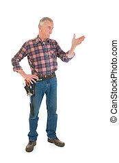 Manual worker - Senior man as manual worker standing in...