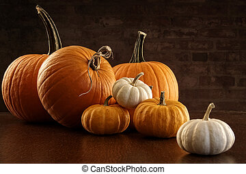 Pumpkins and gourds on table
