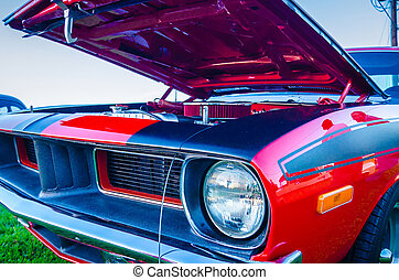 under the hood of a classic muscle car engine compartment