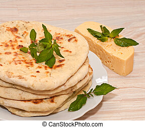 tortilla with cheese and mint on white plate