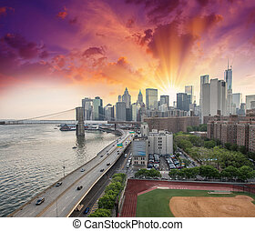 New York. FDR Drive and Manhattan skyline at sunset from...