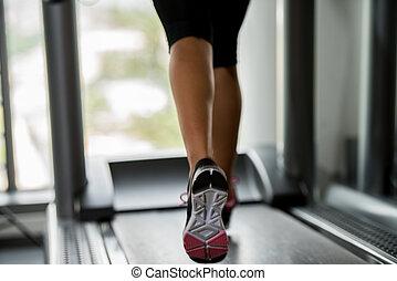 People running on treadmills