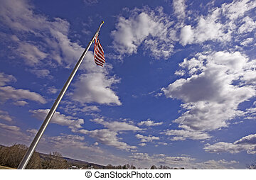 Let Freedom Wave - Against a beautiful blue sky and in a...
