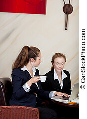 Woman drinking a cup of coffee in the office