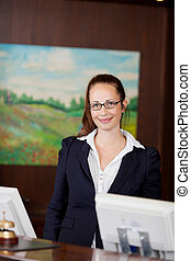 Smiling receptionist at a hotel