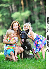 children with dog - girl and her little brother playing with...