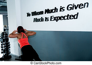 Back view of a muscular woman - A woman works out at a back...
