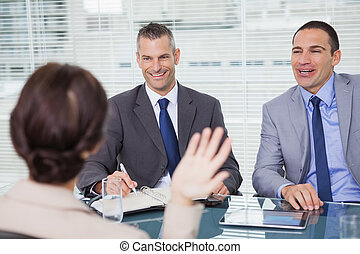 Brown haired woman having an interview in bright office