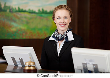 Happy woman working as a receptionist in a hotel - Caucasian...