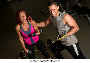 Woman and Man Exercise in the Gym