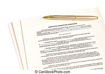 Mortgage assumption agreement with a pen for signature