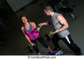 woman exercising with instructor using digital tablet