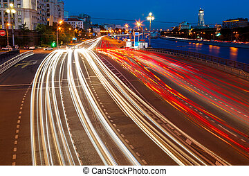 road traffic in the evening on embankment