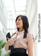 asian chinese female student in formal wear A portrait of an Asian college student on campus