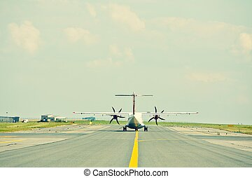 Propeller airplane - Airport - Propeller airplane on the...