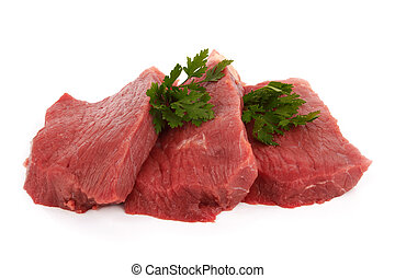 steaks - Three round steaks on a white background