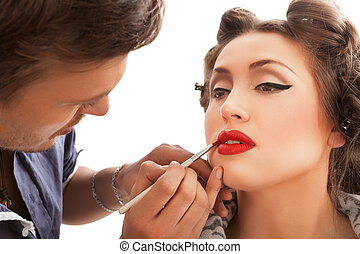 Makeup Applying. Make-up artist applying lipgloss.