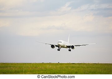 Runway - Airplane is landing at the airport - copy space